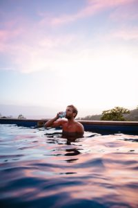 Man Drinking Beer in Pool - Dating Relationship Standards Introverted Alpha